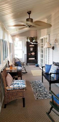 Plenty of seating, Roku TV, two game tables,  two rockers and glorious garden views out on our 3 Season Sunroom. A ceiling fan and thermaseal windows and doors for a beautiful breeze.  Stocked with books and games for all ages.
