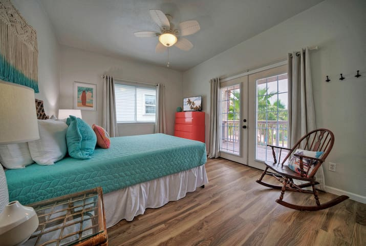 Queen Bedroom with french doors to the front deck.