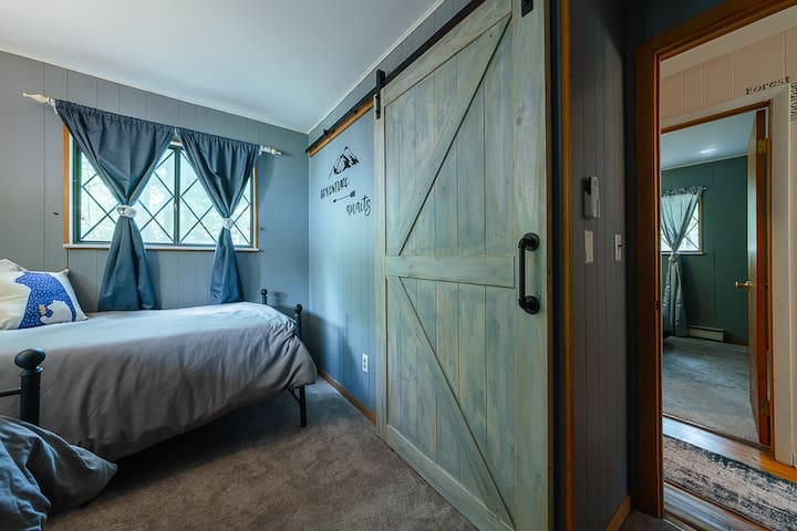 Lower level mountain bedroom with two twins and king conversion kit.