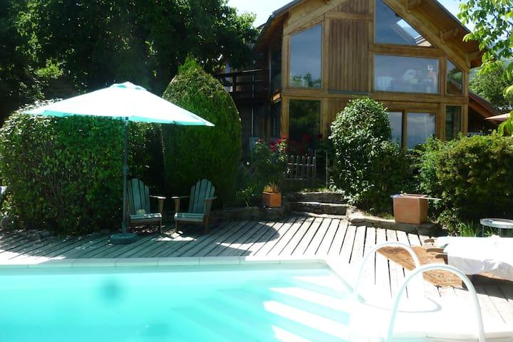 Extension d'une ferme-piscine chauffée-panorama
