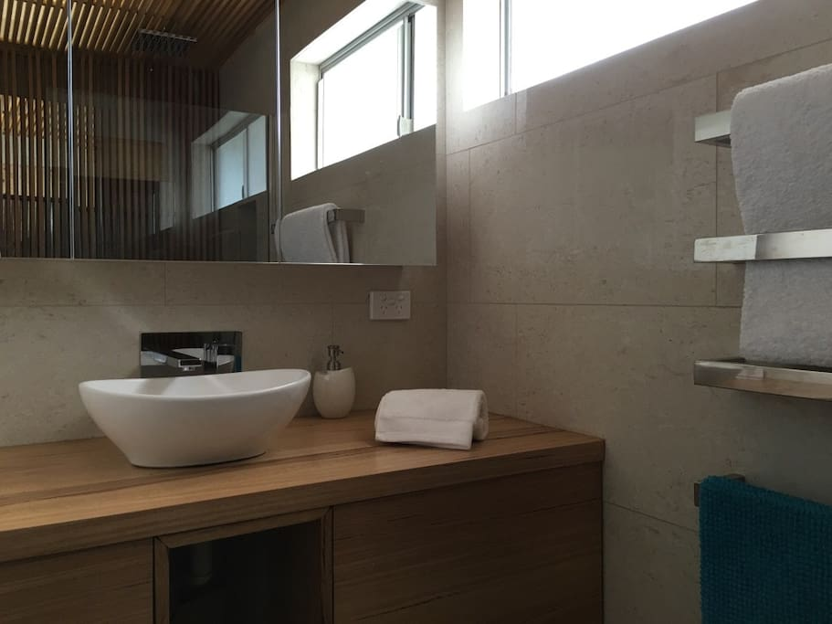 Deluxe travertine and timber bathroom