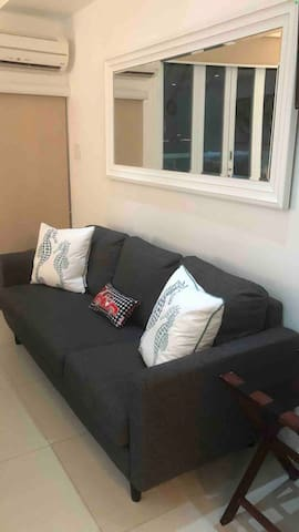 Sofa for relaxing in A/C unit studio