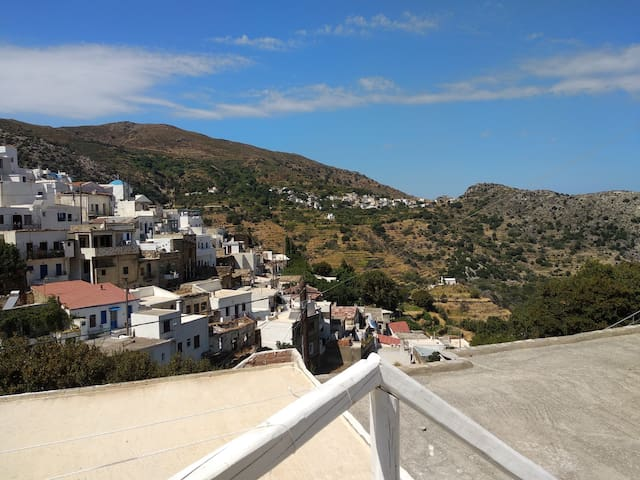 Cycladic house with view in the village heart