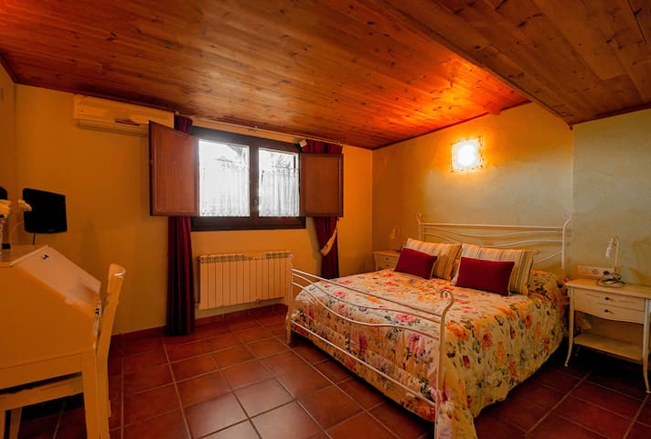 Bedroom 1: double Queen size bed with desk, television and ensuite bathroom