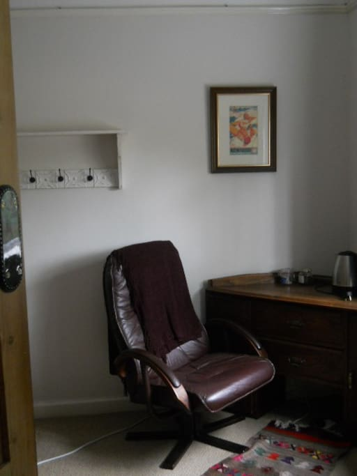 writing desk and chair in guest room.