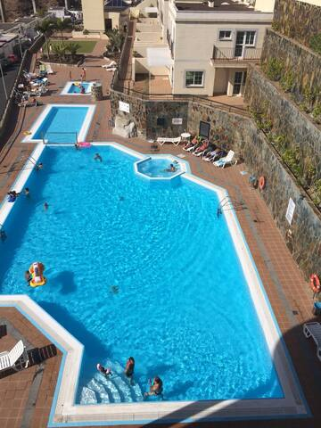 luxury apartment next to swimming pool
