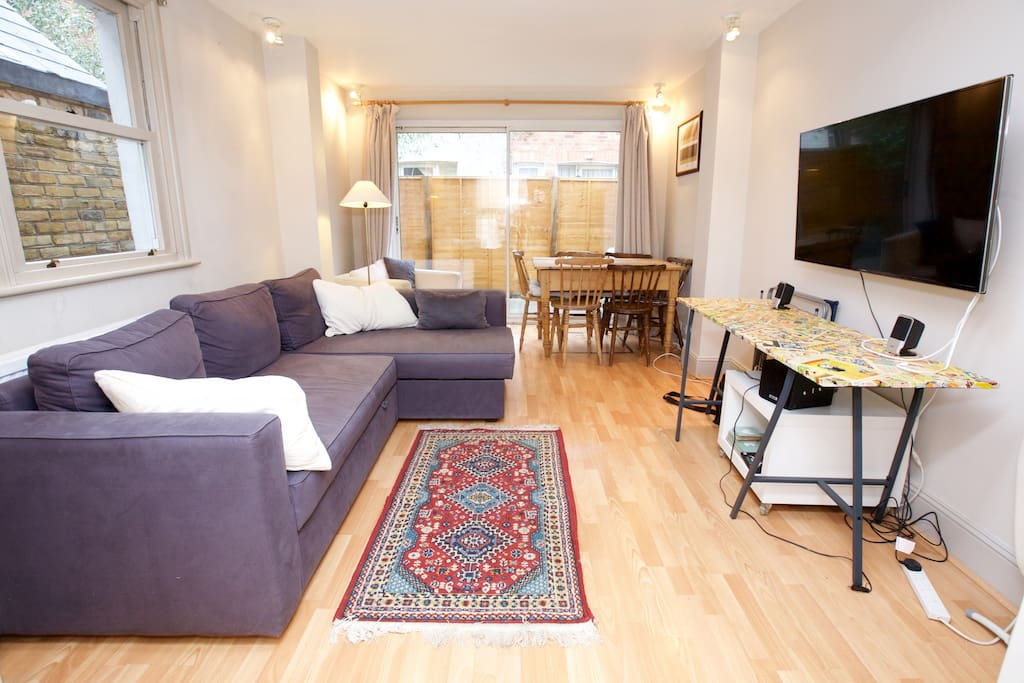 Living room with 50 inch TV (netflix etc), large L shaped sofabed, dining table seats 6 people.