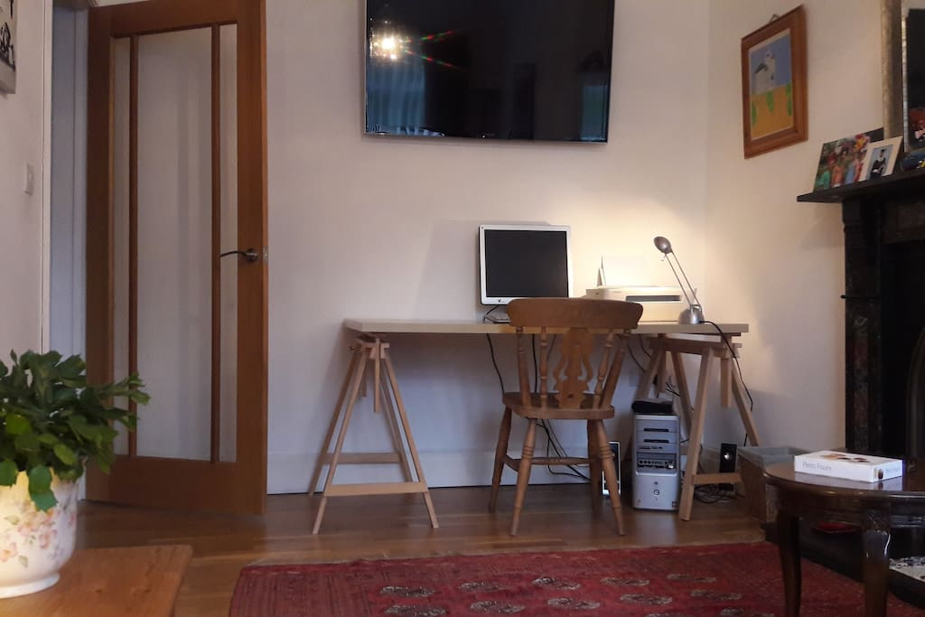 Guests lounge with TV and work desk