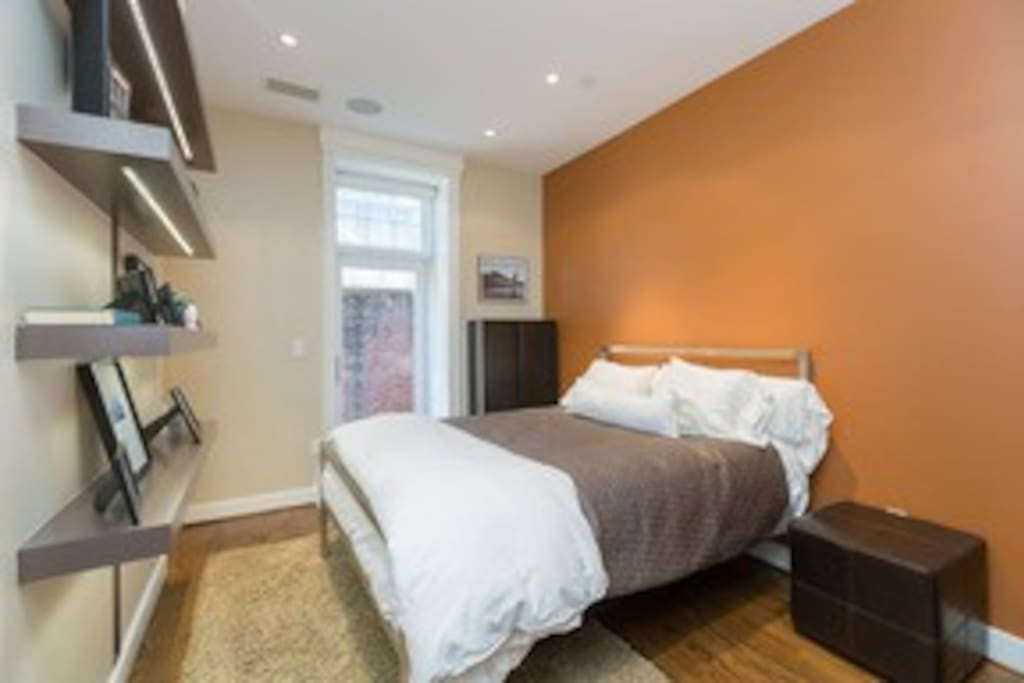 Queen-sized bed, ample closet space, access to private patio with en-suite bathroom.