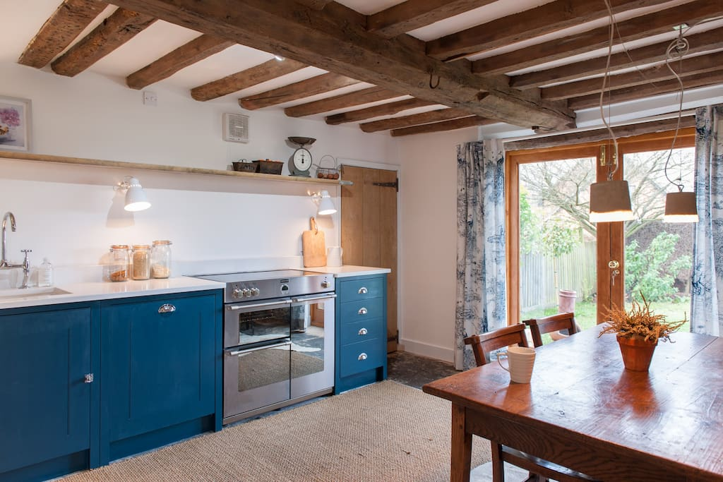 Lovely kitchen with French doors out to the garden.