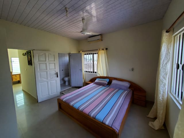 En suite Master bedroom showing attached bathroom