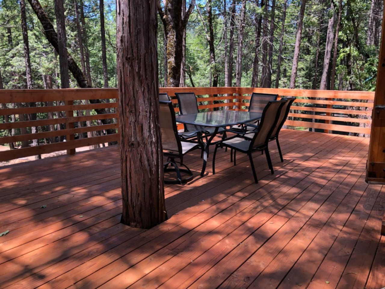 Beautiful, huge, shaded deck with outdoor table and chairs