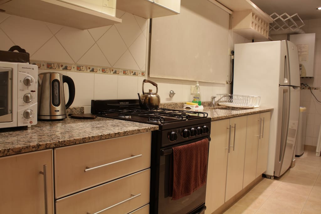 You'll find everything you need in a fully equipped kitchen: big no-frost refrigerator, gas stove/oven, microwave, toaster oven, toaster, regular/electric kettle, cooking utensils.