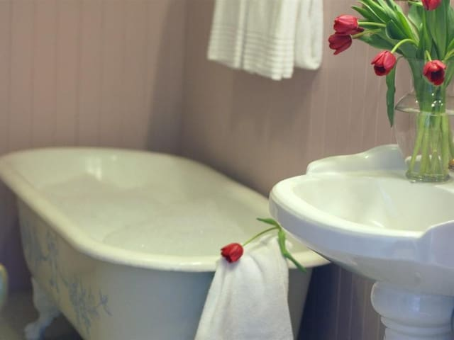Private to the Sunroom is the Mansion's original bathroom and clawfoot tub. The Sunroom is its own oasis with private balcony overlooking the gardens.