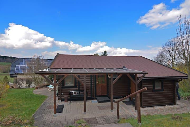 Modern wooden house in Sauerland near Diemelsee with separate children's playhouse