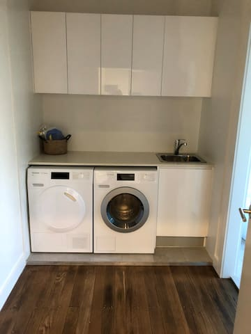 Our laundry has brand new Miele Washing Machine and Dryer