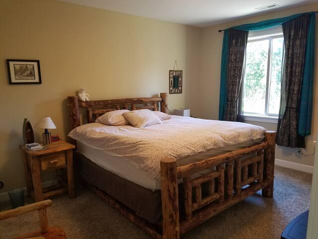 Bedroom #1 with California King custom built log bed