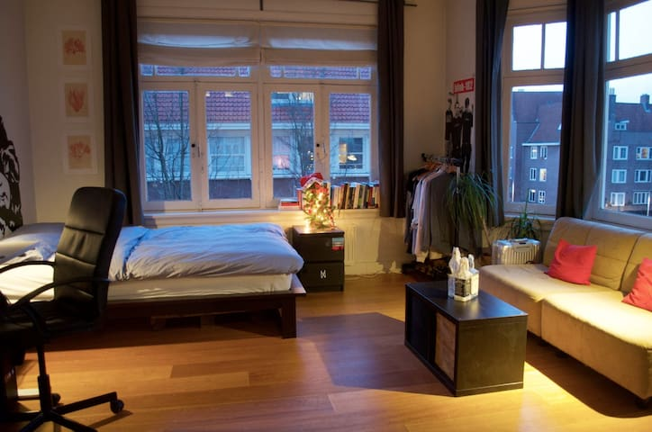 Cozy Bedroom Corner View over Square in Amsterdam