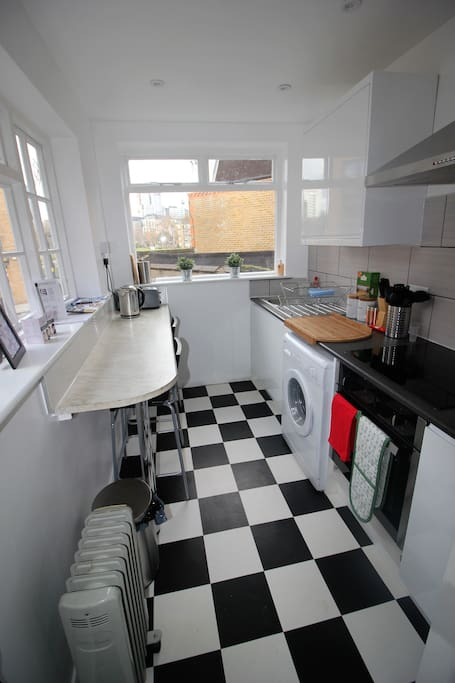 Kitchen situated on 1st floor includes washing machine, cooker & fridge
