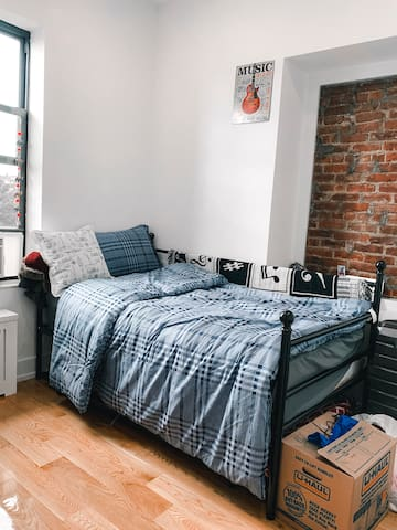 Cozy Bedroom on Broadway, steps from the Subway