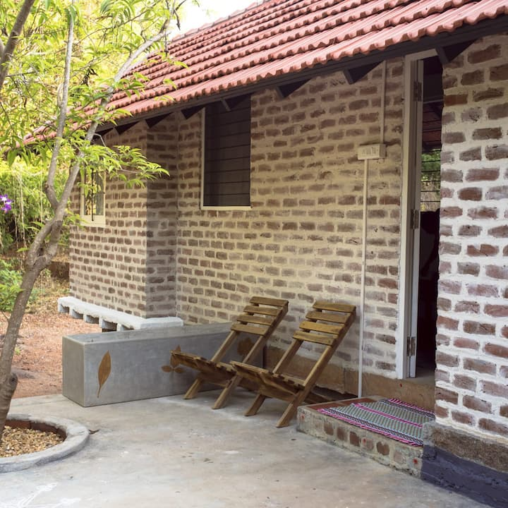 Cottage nestled in an Auroville enchanted forest