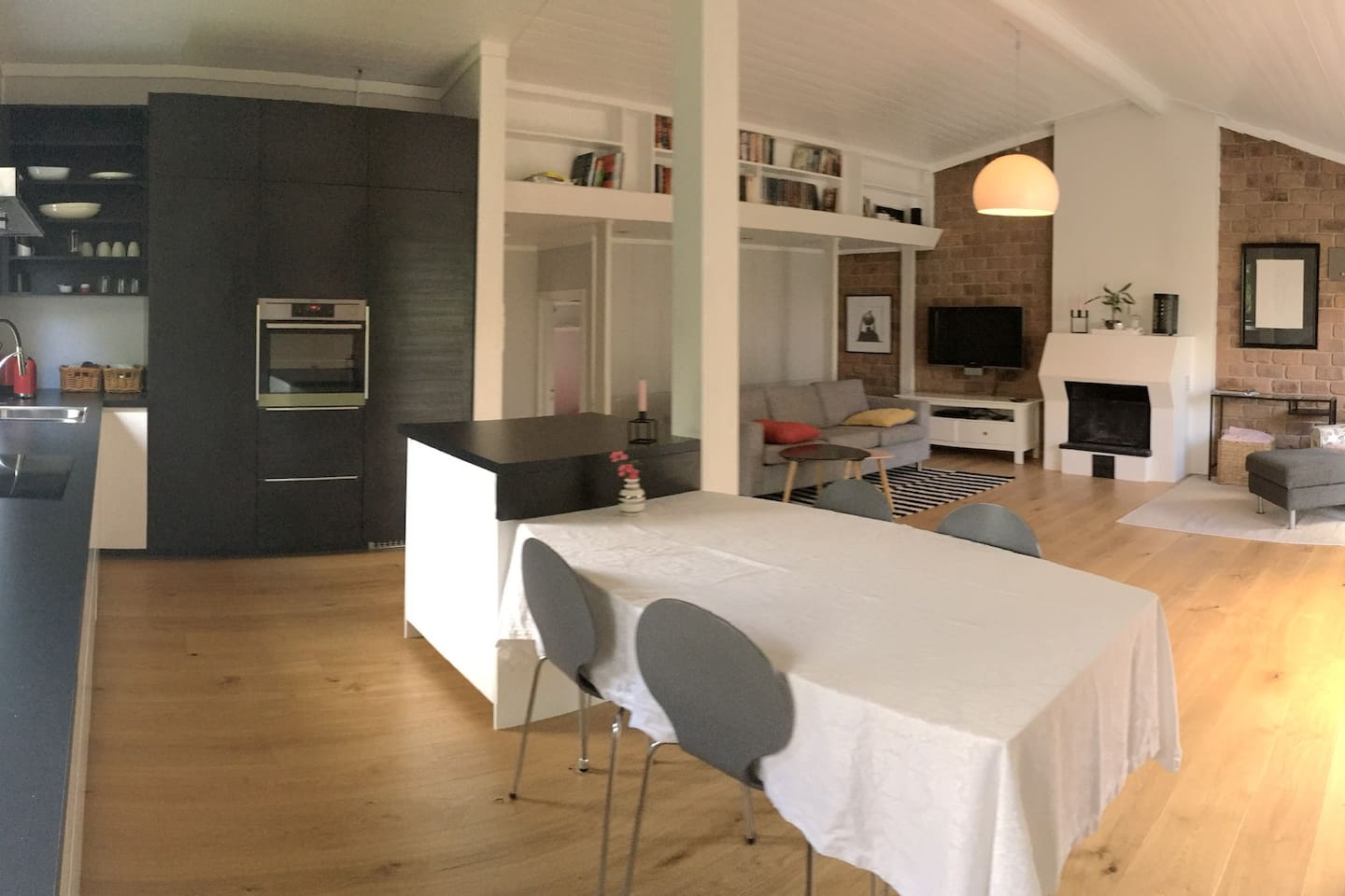 Open kitchen and living room area, with entrance to the beautiful garden