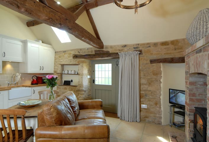 Ground floor:  Open-plan living area with wood burning stove