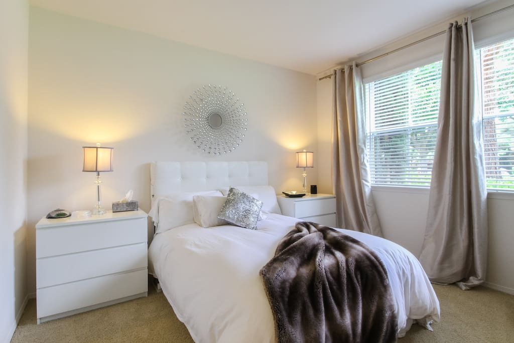 Master bedroom is large with flat screen tv, plenty of drawers and two large windows.  Blackout drapes for a cozy sleep.