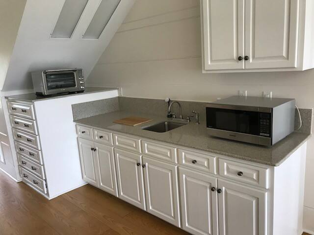 Kitchenette with Open Air Oven, microwave and induction burners.  Large refrigerator as well.  All for personal use by our guest.