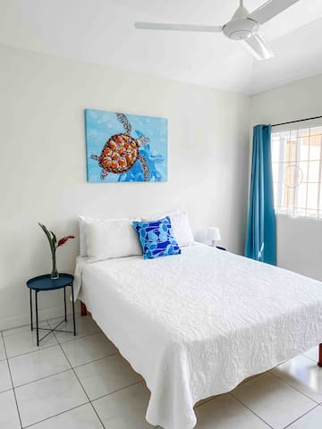 Bedroom 2 - Queen size bed complete with ceiling fan and air conditioning unit