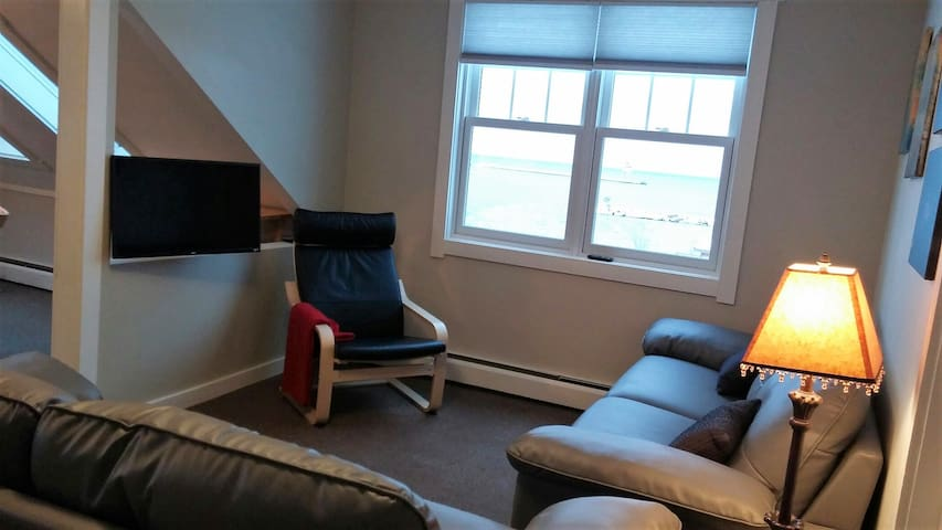 Living area overlooking the Grand Marais harbor and lighthouse9
