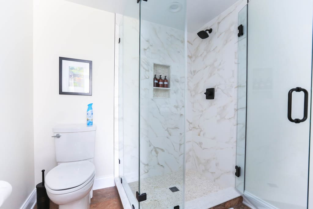 Fresh brand new bathroom. Shower with shampoo, conditioner and body wash provided.