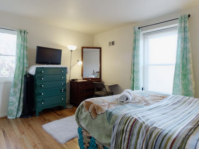 Cozy queen bed, dresser and HDTV for your convenience