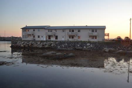 Lofoten Quayside. Midnight sun and white beaches. - Vestvågøy