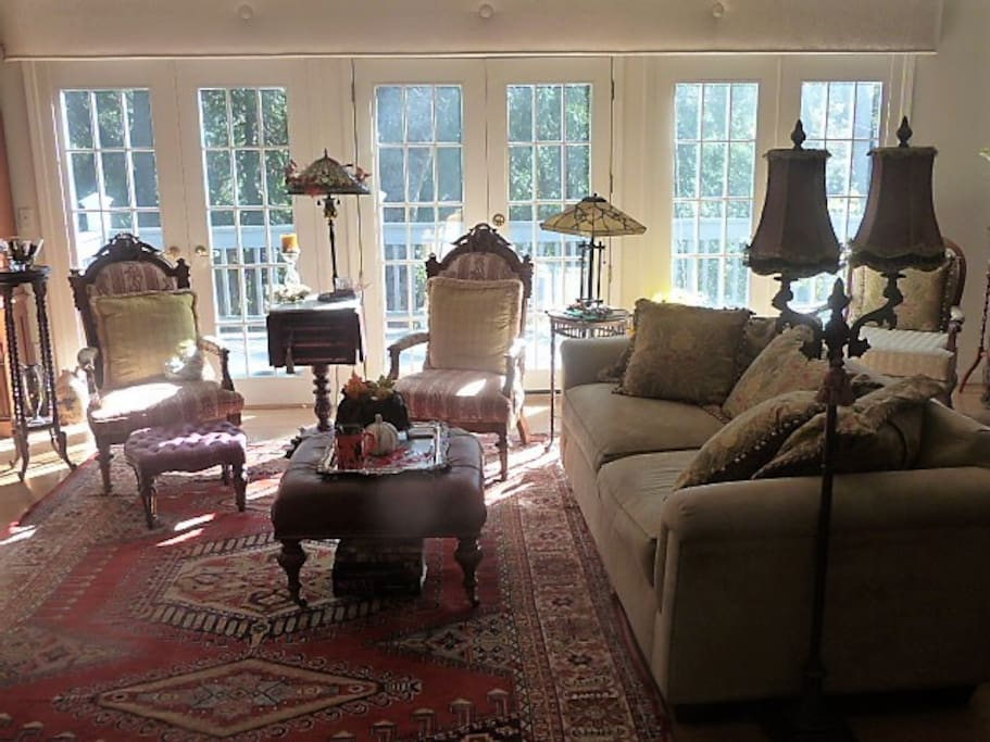 Living room that looks out onto lower deck and the garden & forest beyond