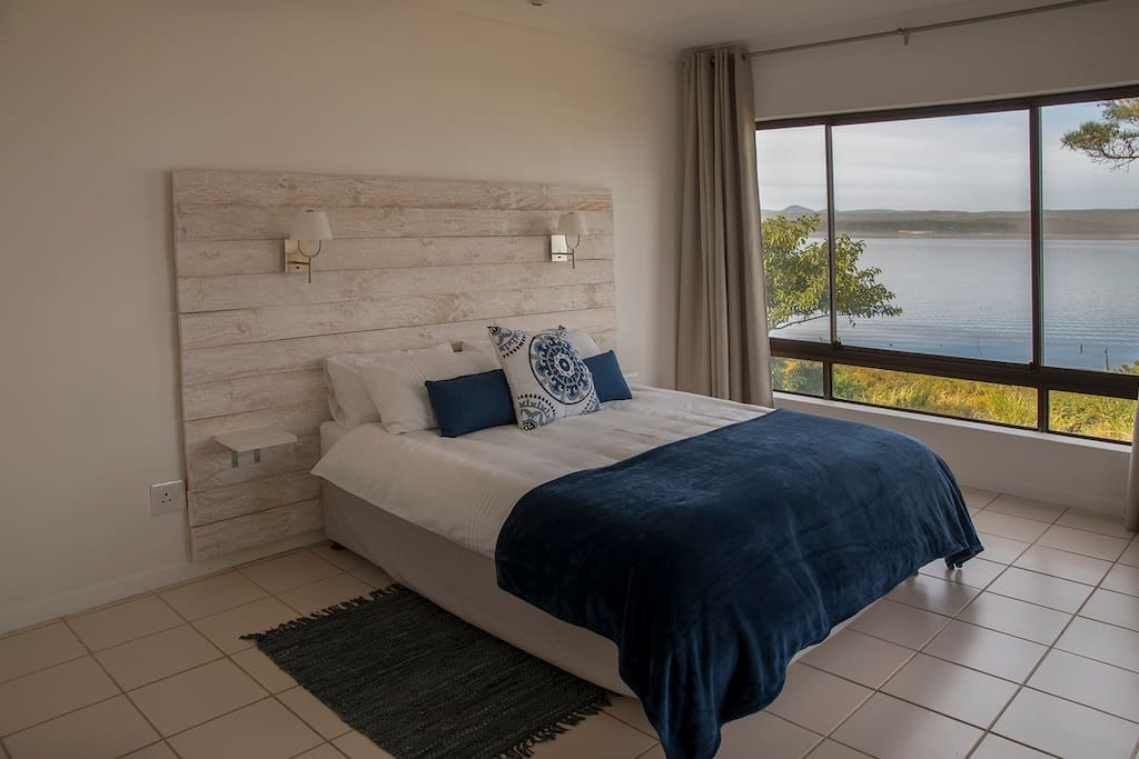 Master bedroom with views of the lagoon, built-in cupboards and ensuite bathroom. Direct access to the patio via french doors.