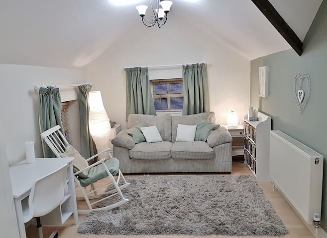 Upstairs Studio Room – Double Sofabed, Wardrobe, Desk, Dressing Table