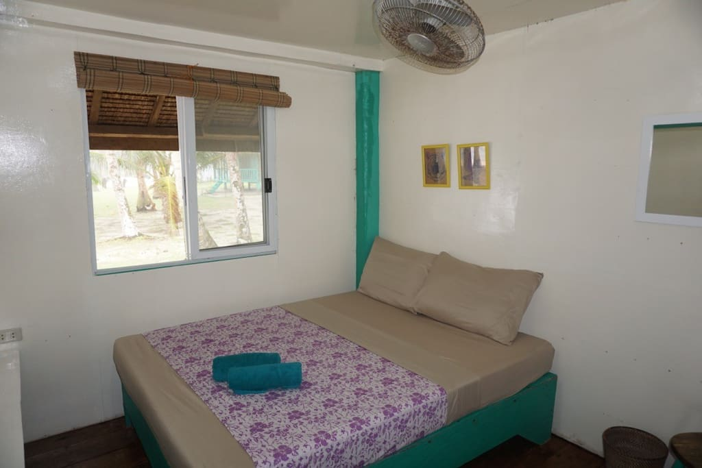 Double bed, large windows and fan