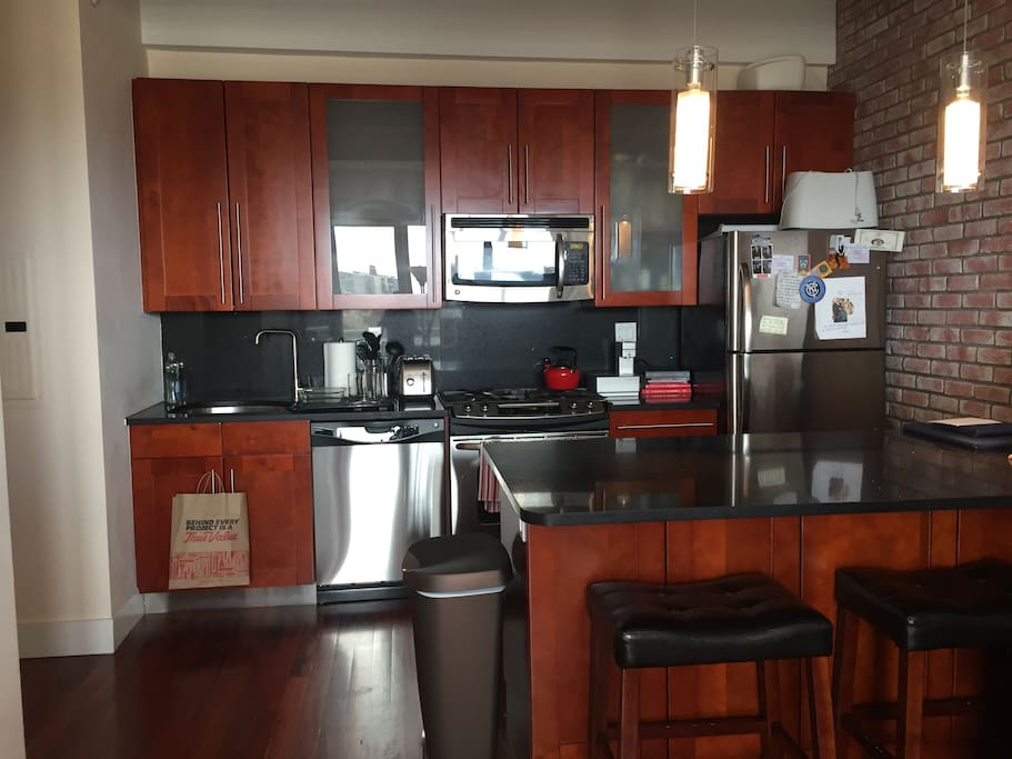 Full kitchen equipped with dishwasher, oven, microwave and refrigerator