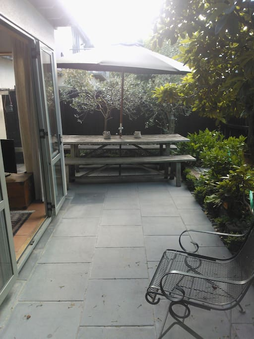 Courtyard - This table has been replaced with a small round one and two chairs.