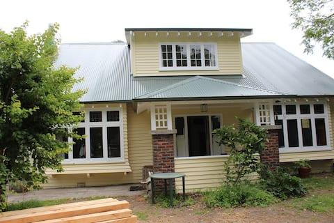 Riverside Retreat - with Pohutakawa Grove