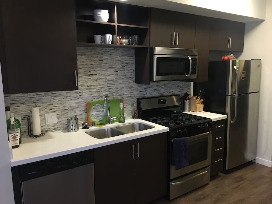 Full kitchen with dishwasher, gas stove/over, and a microwave!