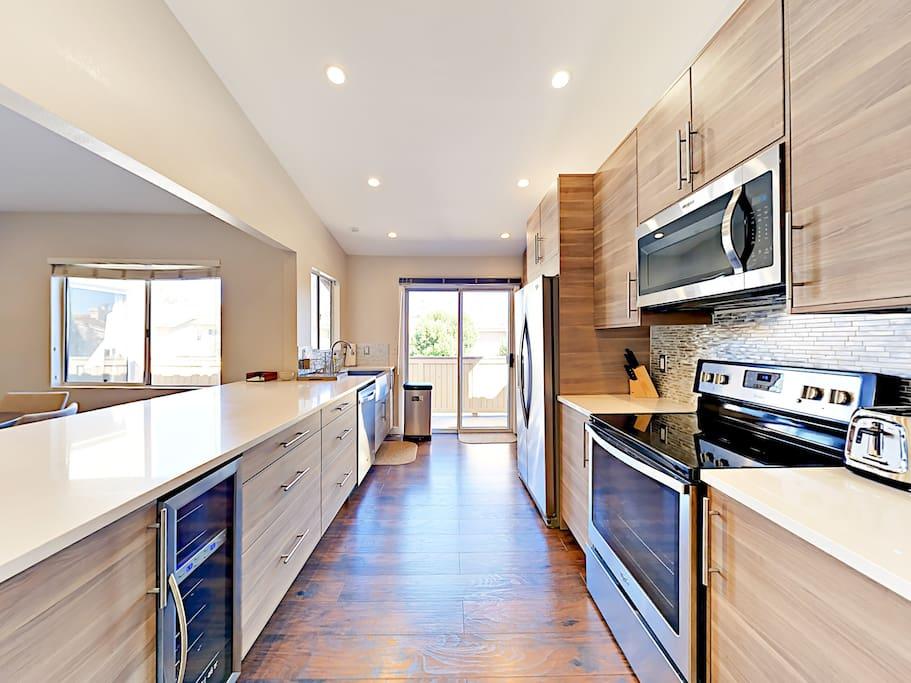 Modern appliances fill the modern galley-style kitchen.