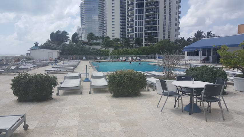 Free lounge chairs and umbrellas at the pool
