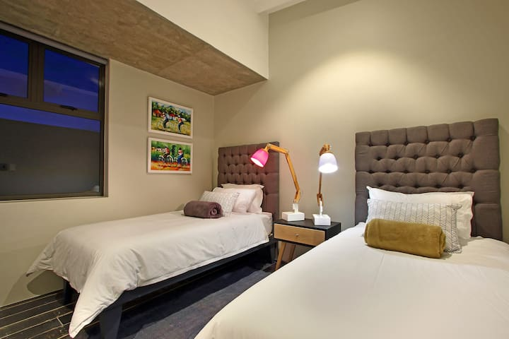 2 x Single beds (or King size bed on request) with ceiling fan in room