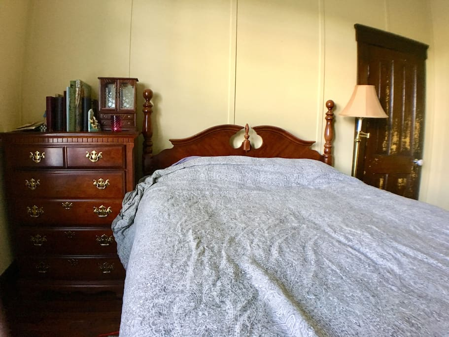 This is our cozy queen bed in the original Masters Suite.