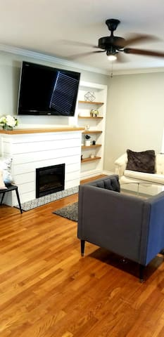 """Simple, clean, classy living room with electric fireplace and 55"""" TV! Connected to Amazon firestick with Netflix, hulu....etc."""