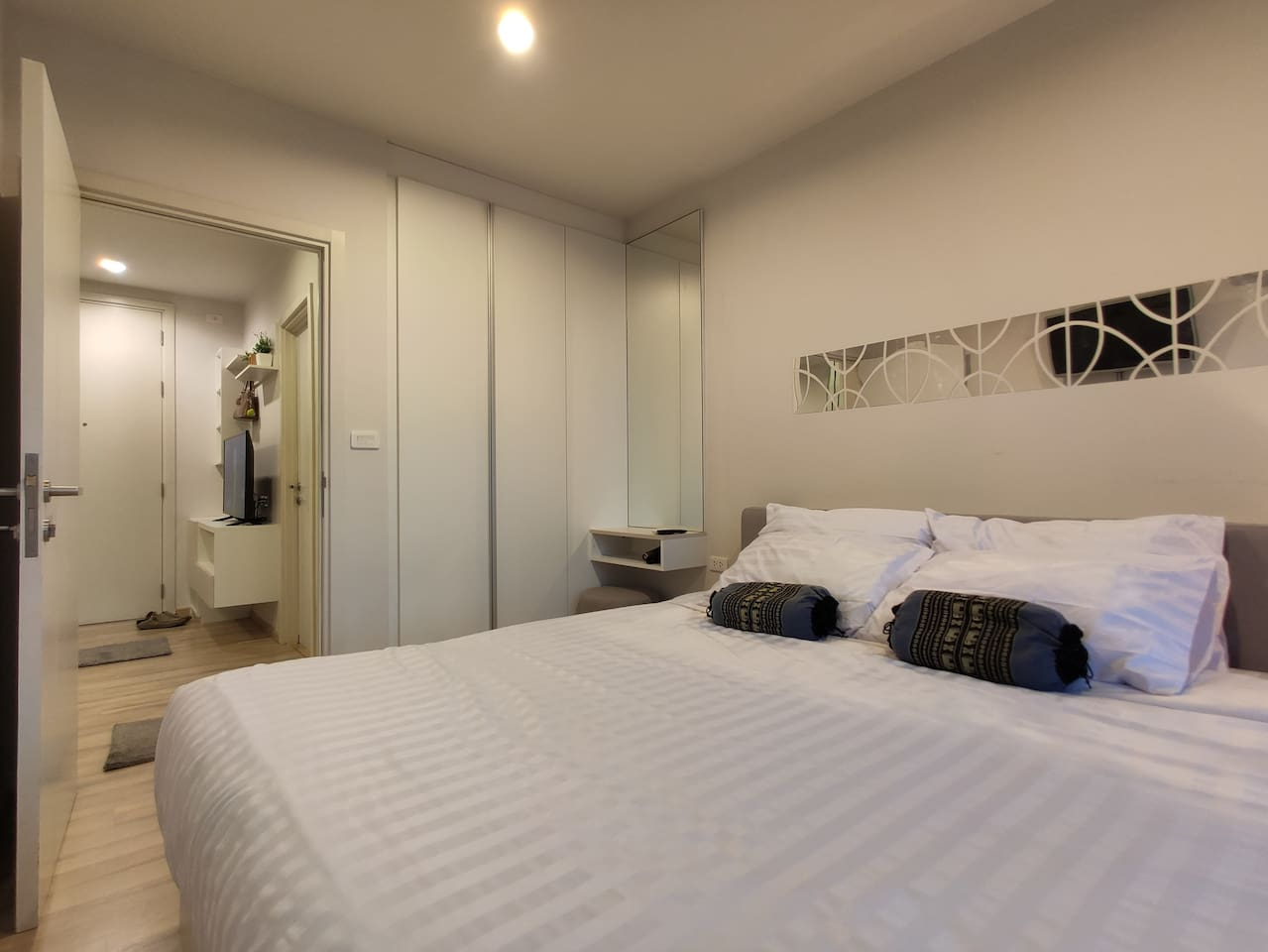 The bedroom with the makeup table, wardrobe, Ironing board in side the wardrobe and hairdryer. Premium pocket spring mattress for your sleeping quality, you can sleep all day without boring. (TV also in the bedroom)