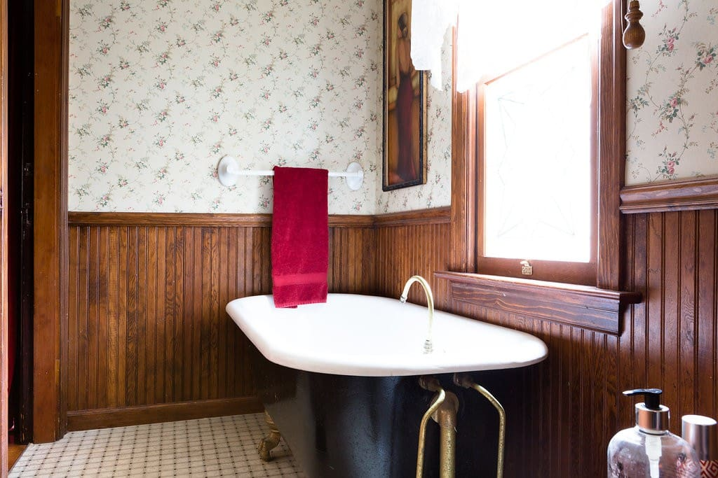 The bath just outside the Den hosts a 100 yr old soaking tub that is original to the house that was built in 1894.