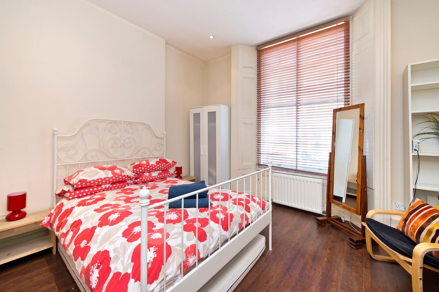 Spacious double room benefiting from hard wood flooring